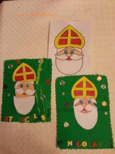 coller le visage de St Nicolas sur un support cartonné, préalablement peint ou décoré de papier crépon, soie etc...